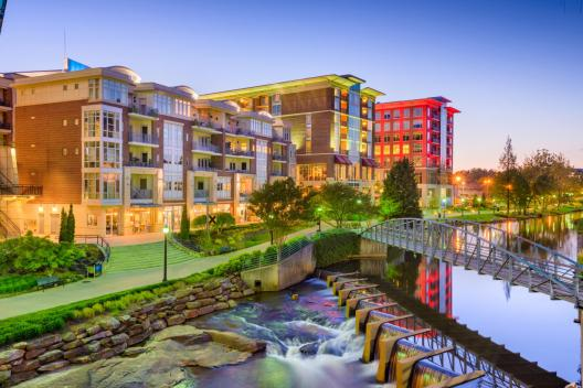 Shops, restaurants, and hotels by Greenville's Reedy River